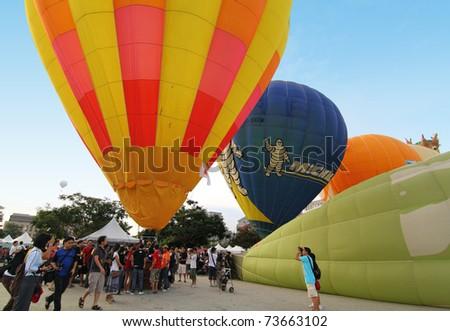 PUTRAJAYA, MALAYSIA - MARCH 19: Total 29 balloonists from 13 countries take part in 3rd Putrajaya International Hot Air Balloon Fiesta 2011 on 19 March, 2011 in Putrajaya, Malaysia. - stock photo