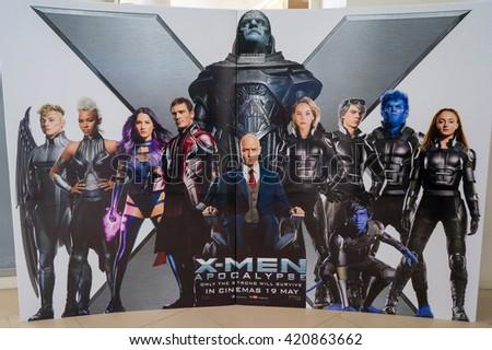 PUTRAJAYA, MALAYSIA - MAY 15, 2016: A wall sized X-Men: Apocalypse poster displayed at IOI Putrajaya Mall. X-Men: Apocalypse premieres is on May 27, 2016 - stock photo