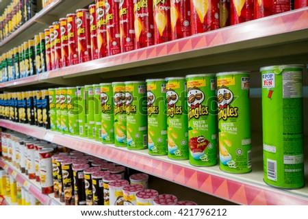 PUTRAJAYA, MALAYSIA - MAY 15, 2016: Rows of Pringles Snacks inside hypermarket in Putrajaya, Malaysia. - stock photo