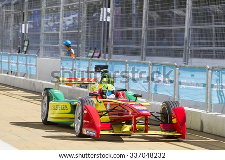 Putrajaya, Malaysia - November 7, 2015 : Brazillian Lucas de Grassi of Team ABT Schaeffler Audi exits pitlane at FIA Formula-e ePrix Championship Putrajaya, Malaysia - stock photo