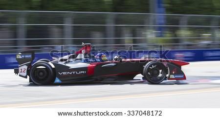 Putrajaya, Malaysia - November 7, 2015 : Jacques Villeneuve of Team Venturi enters turn 2 at FIA Formula-e ePrix Championship Putrajaya, Malaysia - stock photo