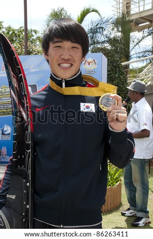 PUTRAJAYA, MALAYSIA - OCTOBER 9: Kim See Hyung from Korea wins the gold medal at 2011 IWWF Asian Waterski & Wakeboard Championships in Putrajaya, Malaysia on October 9, 2011. - stock photo
