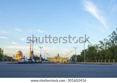PUTRAJAYA, MALAYSIA - OCTOBER, 6: Traffic at Prime Minister's office on October 6, 2013 in Putrajaya, Malaysia. The building is called Perdana Putra and design is influenced by Malay Islamic culture - stock photo