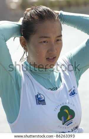 PUTRAJAYA, MALAYSIA - OCTOBER 9: Yu Fei Song from China after showing skills at 2011 IWWF Asian Waterski & Wakeboard Championships in Putrajaya, Malaysia on October 9, 2011. - stock photo