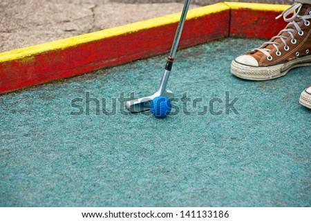 Putting at a mini golf leisure facility - stock photo