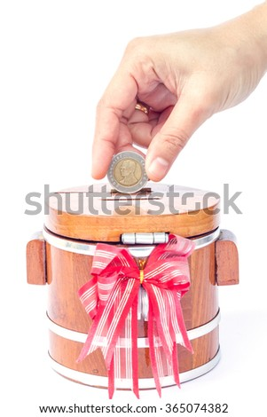 Putting coin to save money, stock photo - stock photo