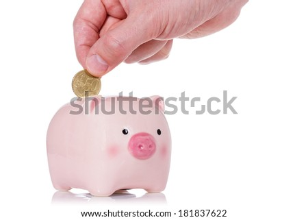 Putting fifty cent into the piggy bank isolated on white background