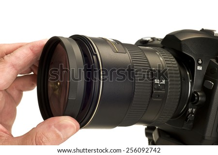 Putting Filter On Camera Lens  - stock photo