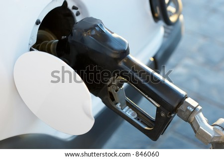 Putting gas in a car - stock photo