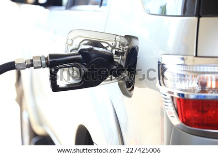 Putting in gasoline - stock photo