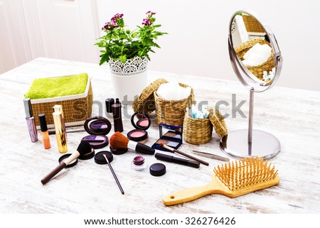 Putting on make up before going out - stock photo