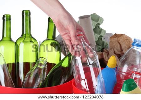 Putting plastic bottle into recycling bin, closeup - stock photo