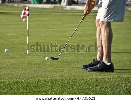 Putting Practice Before Golf Tournament - stock photo