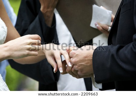 Putting the ring on the bride during a wedding ceremony