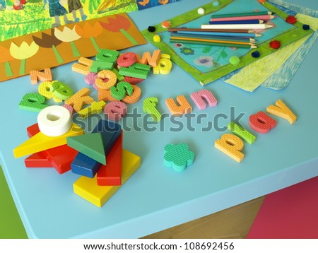 Puzzle, bricks, paintings and crayons for child - stock photo