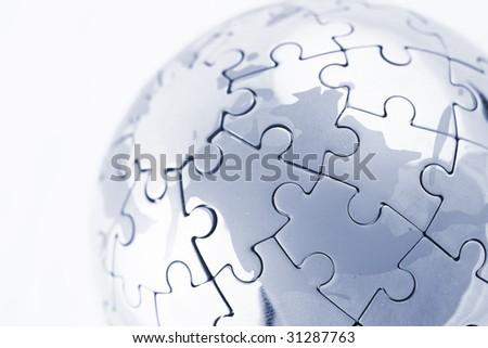 puzzle globe isolated over a white background - stock photo