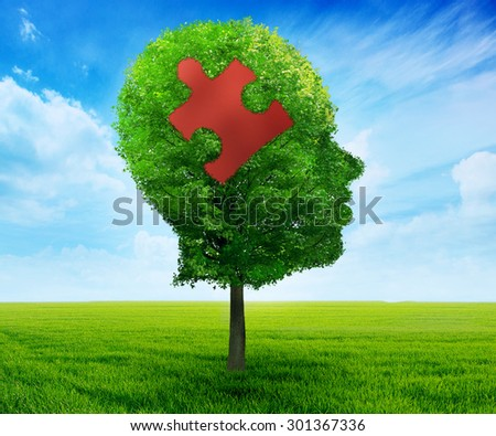 Puzzle head brain learning symbol. Tree in a shape of human head face profile with jigsaw piece isolated on blue sky background.mental health concept  - stock photo