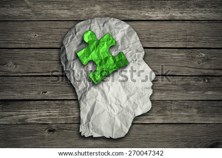 Puzzle head solution concept as a human face profile made from crumpled white paper with a jigsaw piece cut out inside the brain area on old wood background. Mental health symbol.  - stock photo