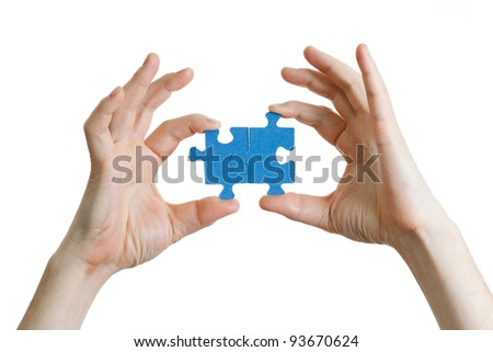 puzzle in hands isolated on white