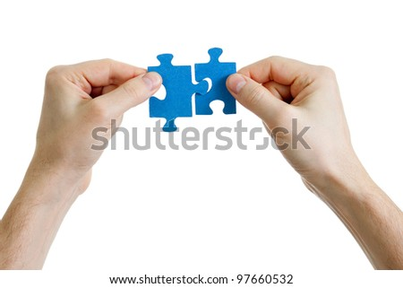 puzzle in hands isolated on white - stock photo