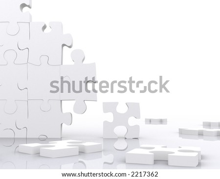 puzzle in pieces over a white background - stock photo