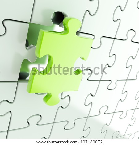 Puzzle jigsaw shiny metal background with one green piece stand out - stock photo