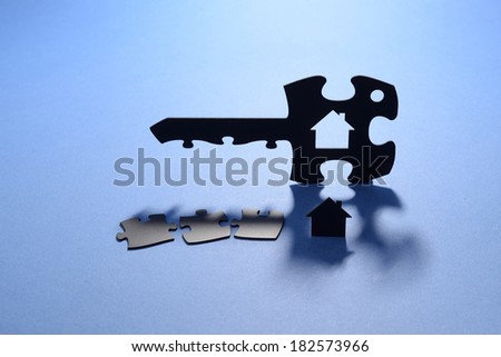 puzzle key for house - stock photo
