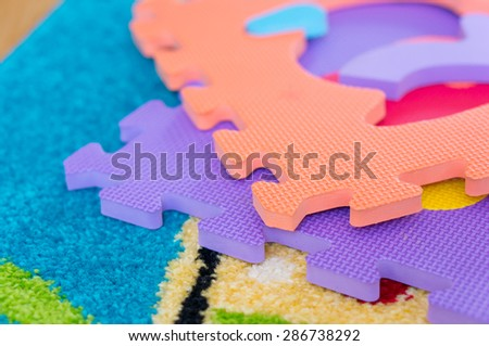 Puzzle mat parts on soft carpet