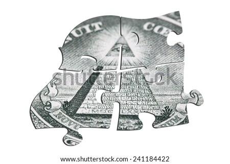 Puzzle of dollars. Isolated on white background - stock photo