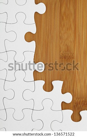 Puzzle on wooden board - stock photo