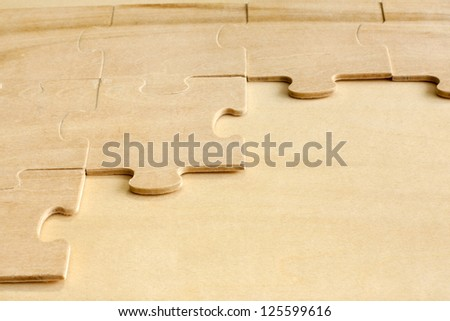 Puzzle on wooden boards abstract background - stock photo