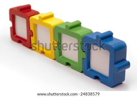 Puzzle photo frames in a row, in various colors, and isolated on white background. - stock photo