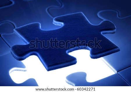 puzzle piece coming down into it's place. - stock photo