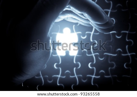puzzle piece down into place