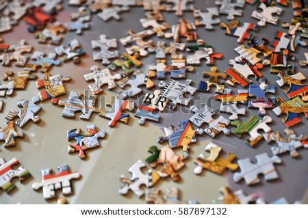 Puzzle PiecesA Pile Of Pieces On A Surface Jigsaw The