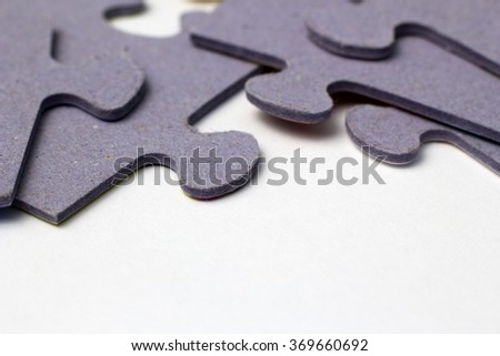Puzzle pieces on a paper close - stock photo