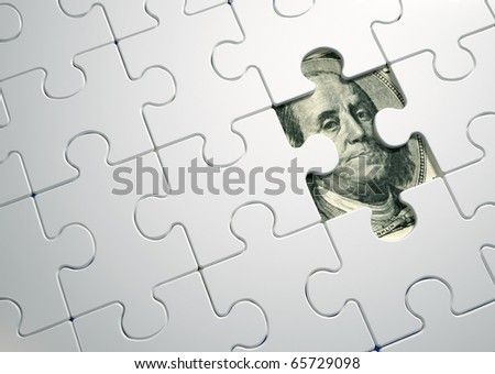 Puzzle pieces on dollar - this is a 3d render illustration - stock photo
