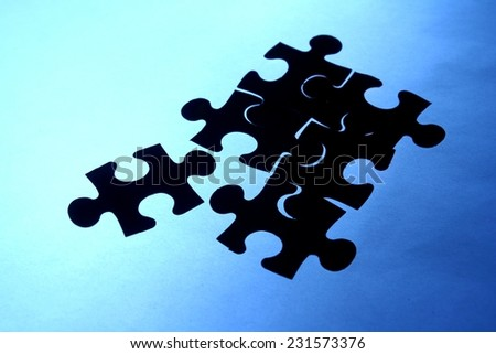 Puzzle with a loose piece Photo of a puzzle with one loose piece
