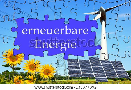 puzzle with sunflower, solar panel and wind mill with the german words renewable energy / renewable energy - stock photo