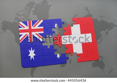 puzzle with the national flag of australia and switzerland on a world map background. - stock photo
