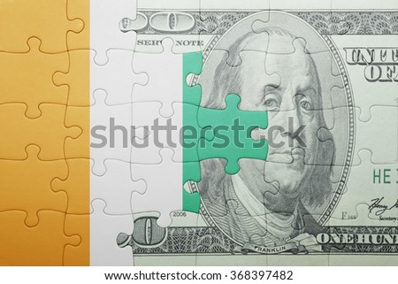 puzzle with the national flag of cote divoire and dollar banknote . concept