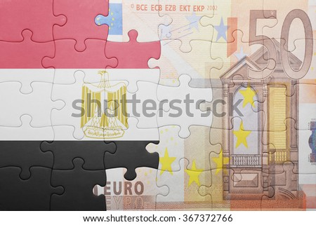 puzzle with the national flag of egypt and euro banknote . concept - stock photo