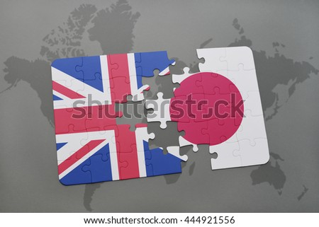 puzzle with the national flag of great britain and japan on a world map background. - stock photo