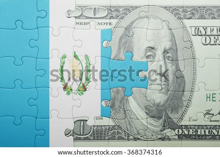 puzzle with the national flag of guatemala and dollar banknote . concept