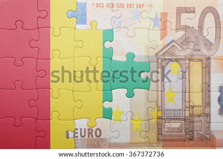 puzzle with the national flag of guinea and euro banknote . concept - stock photo