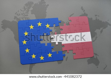 puzzle with the national flag of latvia and european union on a world map background. - stock photo