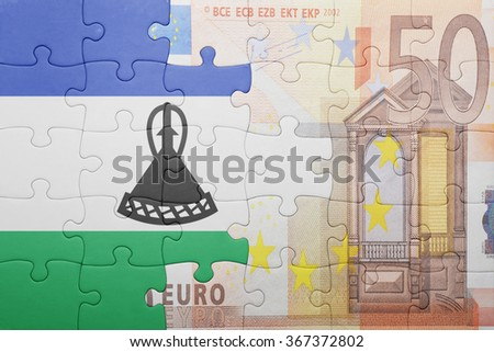 puzzle with the national flag of lesotho and euro banknote . concept - stock photo