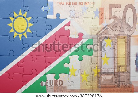 puzzle with the national flag of namibia and euro banknote . concept - stock photo