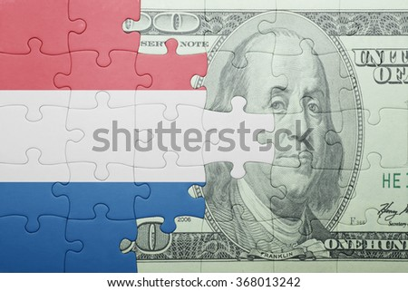 puzzle with the national flag of netherlands and dollar banknote . concept