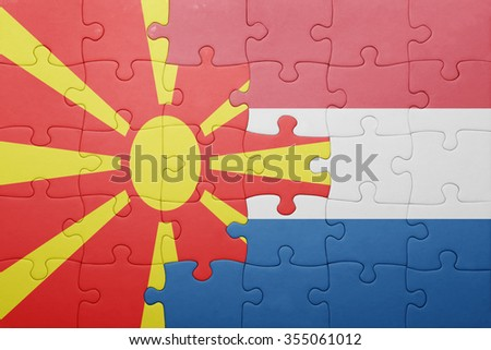 puzzle with the national flag of netherlands and macedonia . concept